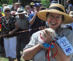 Henley on Mersey Woman holding winner ferret